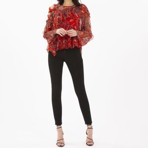 Iro red blouse with shoulder cut out detail
